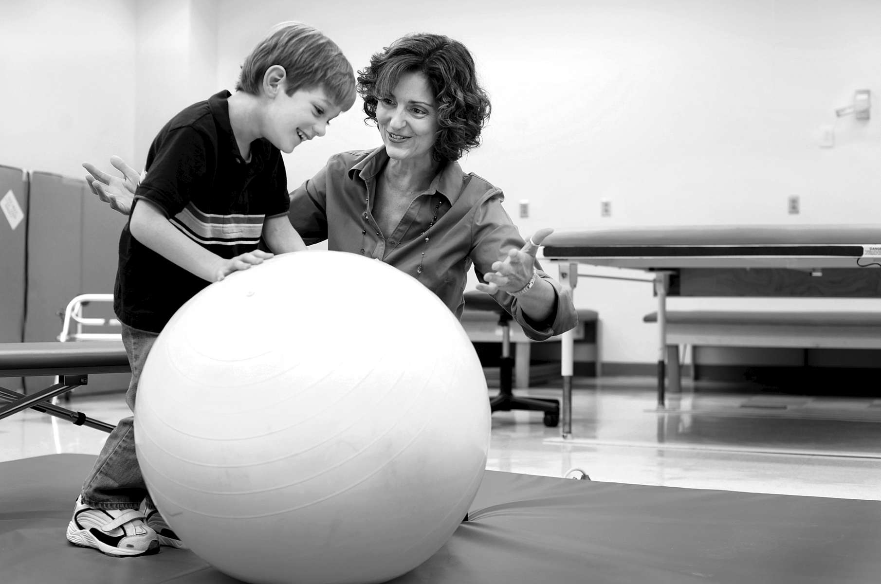 Paula DiBiasio, an assistant professor of physical therapy education at Elon University, works with a client in an on-campus lab.