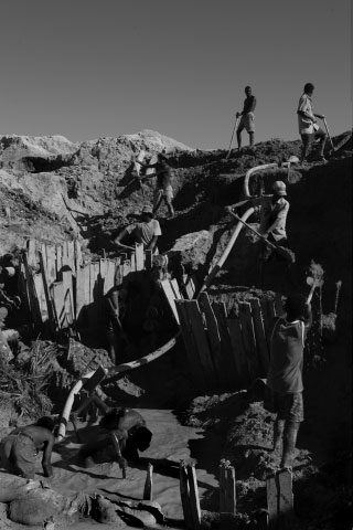 Men dig and place planks to hold off water welling from the ground below. The work is tedious and dangerous. Several people die each year when a mine collapses. The workers are paid in food only and are supposed to get a share of any significant find in the mine. Many mines often yield nothing of value.
