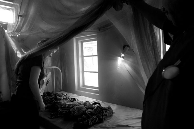 Premature babies are placed beneath a heat lamp and a mosquito net in Lindy Hospital in southern Tanzania. Women in their first pregnancy are particularly susceptible to Malaria and often give birth too early.