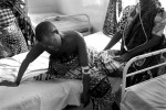 A woman suffers in the last stages of cerebral Malaria in southern Tanzania. She died later that night.