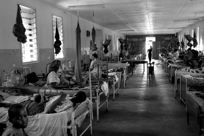 A typical childrens' ward in Teule Hospital. The parents rarely use the few mosquito nets because they are full of holes.