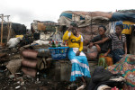 Selling Liquor in a shanty town in Lagos, Nigeria