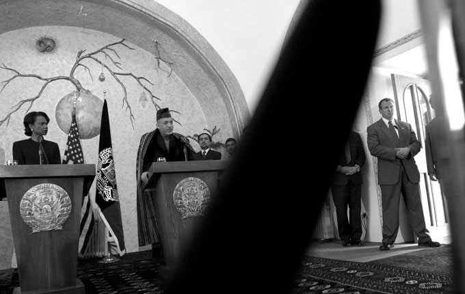 Afghan president Hamid Karzai holds a press conference with Secretary of State Condoleezza Rice in Kabul. American security guards, right, stand close by Karzai at all times.