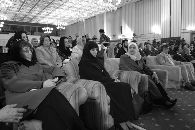 First Lady Zinet Karzai, seated center, attends Women's Day celebrations at the Intercontinental Hotel in Kabul. This was believed to have been her first public appearance although she did not speak. Afghan Human Rights Commission director Sima Saman is seated on the far left.