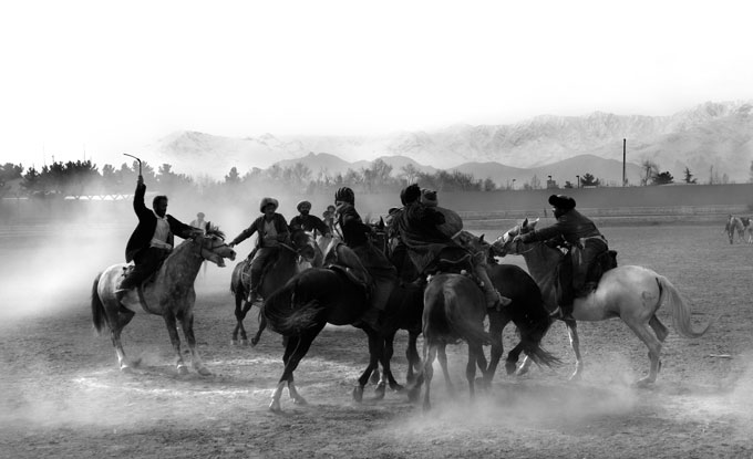A Friday Buzkashi match in Kabul. The sport is a battle, on horses, over a headless goat.