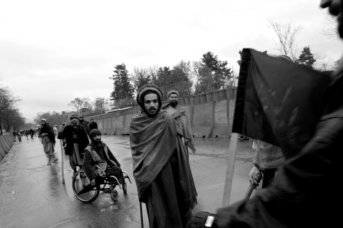 A group of veterans and handicapped Afghan men try to protest near President Karzai's compound. Due to the overwhelming security, they didn't get close.  Afghanistan's brutal and violent history has resulted in large numbers of handicapped and maimed people. Land mines alone are believed to cause at least 100 casualties a month.
