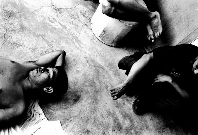 Illegal Immigrants rest at the Casa Migrantes,  a Catholic safe house in Tapachula Mexico near the Guatemala border. These men (left and top) were robbed of everything -- including shirt and shoes. They planned to continue their journey north to the US.