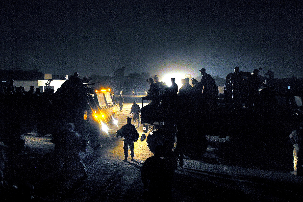 SOLDIERS SUIT UP FOR NIGHT PATROL