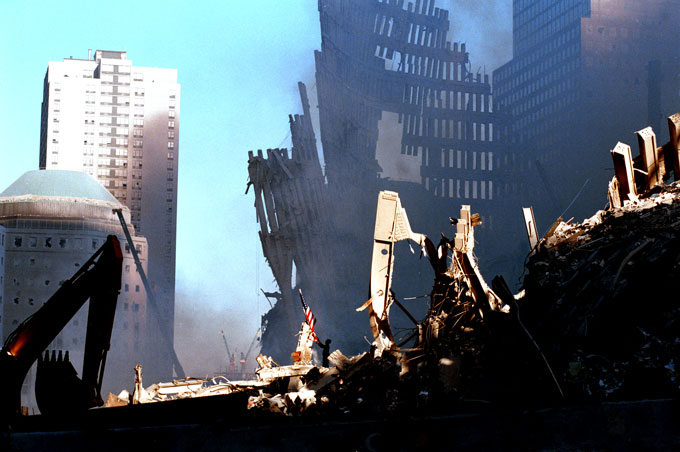 A flag is raised in the rubble at dawn on September 12th.
