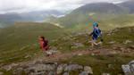 Natalie Hawkrigg and Liz Berry coming off the summit of Robinson during their run of this charity challenge for MS in 2015.