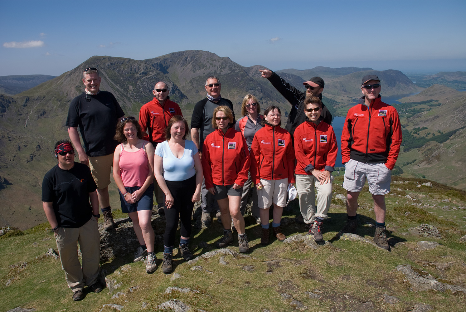 Pete Royall of Wandering Aengus Treks with a group of walkers on Fleetwith Pike looking over Buttermere.