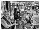 Malcolm Hogarth and friends playing in the market square. Malcolm is a pianist of the liveliest kind and resident with several bands including The Merseysippi Jazz Band, The Blue Magnolia Jazz Orchestra, The Deeside Dixies and The Original Panama Jazz Band