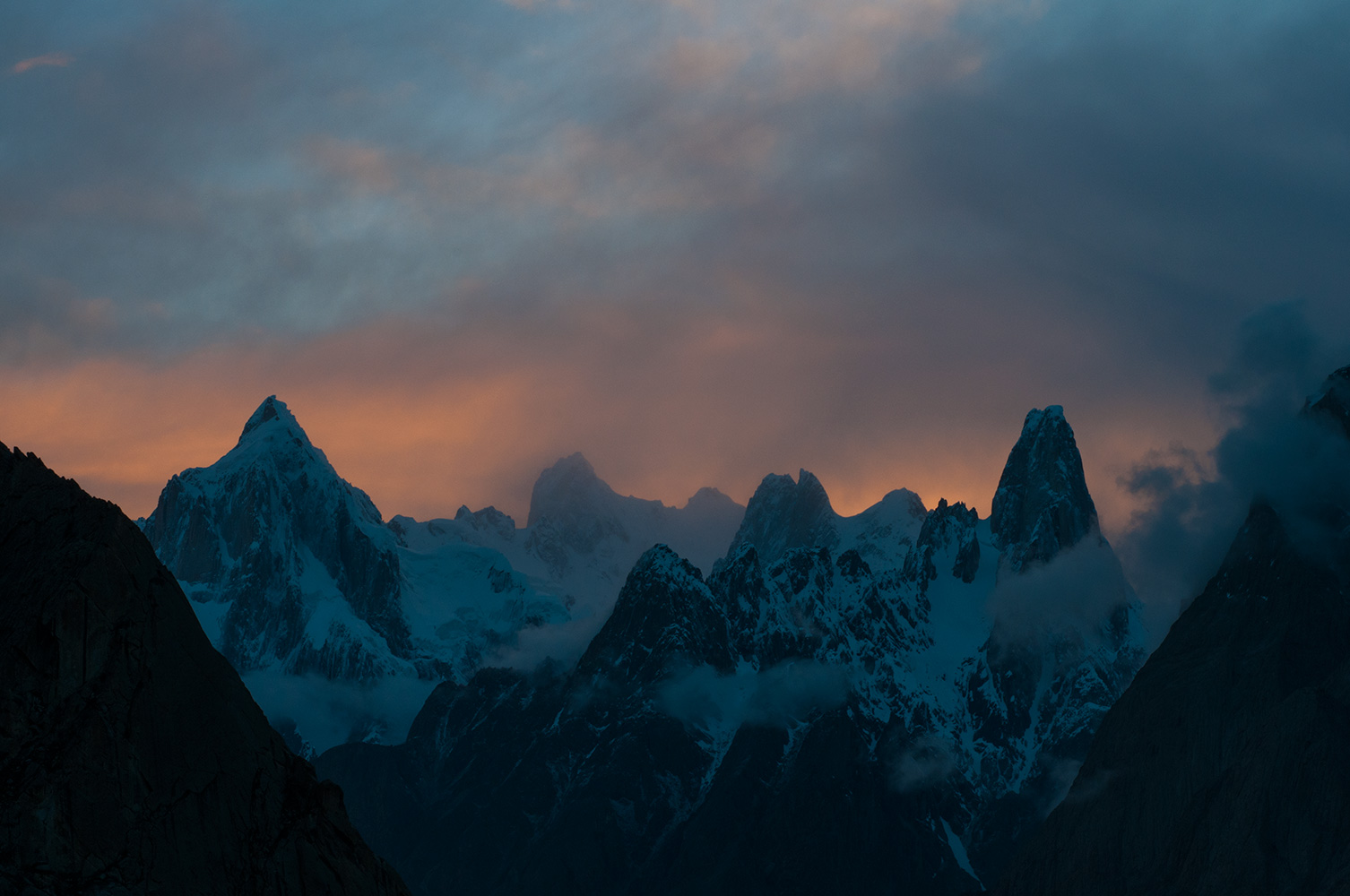Paiju Peak, Uli Biaho etc emerge from breaking cloud at dusk, seen from Khoburtse (Hobutse) camp on the Baltoro glacier. A scene straight out of Tolkein!Nikon D300, 60mm