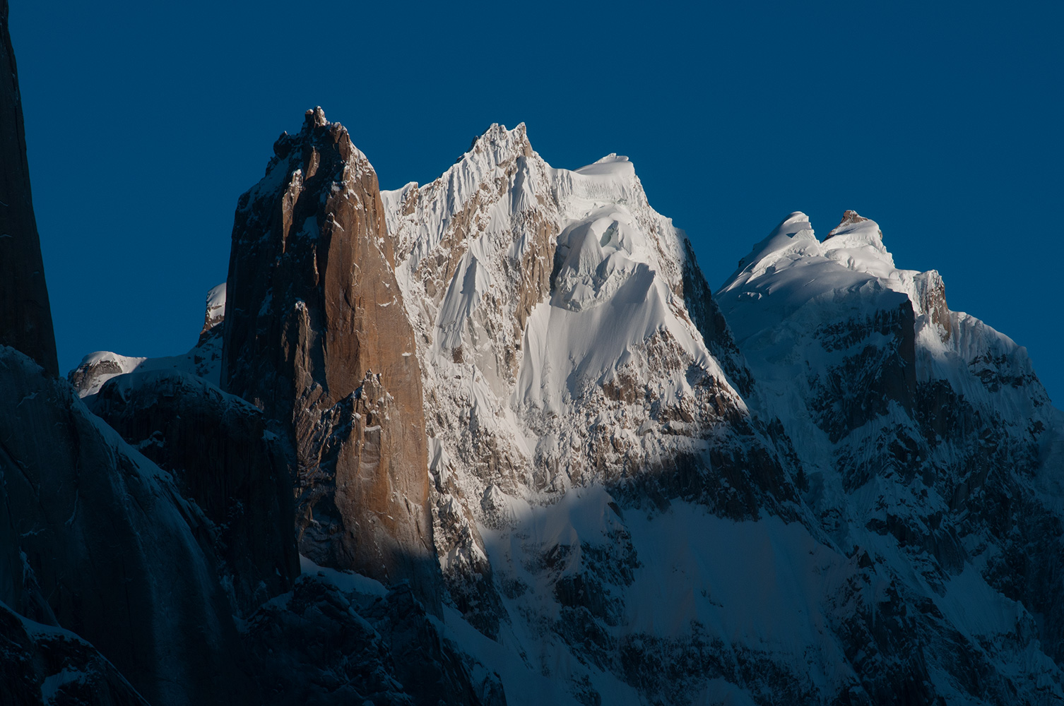 A telephoto at sunrise from Urdokas on the Baltoro glacier.Beyond are Kruksum and Sarpo Lago