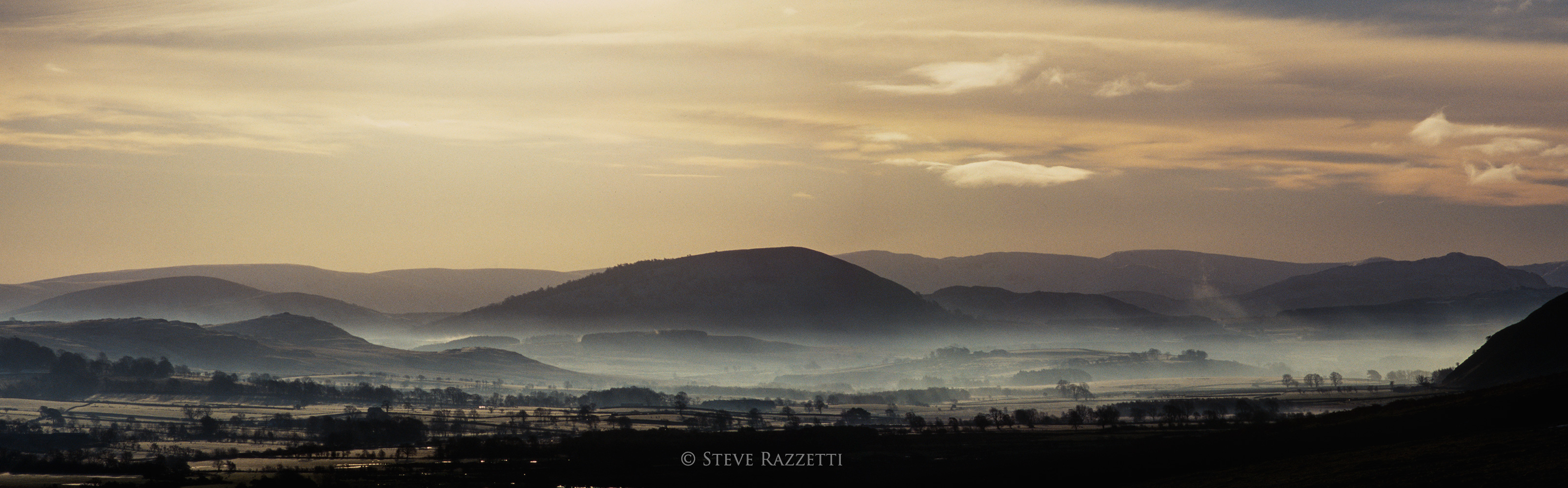 As the winter sun slowly climbs in the sky, the mists in the valley bottoms disperse. This is the view down valley from Calebreck.Nikon D610, 180mm. A stitch of two images.