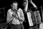 """@ The Upfront, November 17th 2017Fantastic band! Go see them!Rob Heron & The Tea Pad Orchestra don't care what genre you choose to put them in – western swing, country blues, ragtime hokum or whatever else– as long as you understand that they're 100% sincere and 100% immersed in this stuff. This is no lazy pastiche, no dressing up box. They live and breathe this music and want you to get immersed with them.The Tea Pad are seven years into a remarkable story that began with four friends studying at Newcastle University and now sees them playing venues and festivals across the UK and mainland Europe.  Based in Newcastle Upon Tyne but with members hailing from Orkney to Warwickshire, the Tea Pad sound draws on myriad influences – from Bob Wills to Django Reinhardt, George Jones to Tom Waits – yet ultimately sounds like nobody else, that North Eastern Swing style that's utterly their own and changing all the time.Across the four wonderful albums – 2012's """"Money Isn't Everything"""", 2014's """"Talk About The Weather"""", 2016's """"Something Blue"""" and the brand new """"Soul Of My City"""" – the band have constantly added new flavours to their sound: Heron in particular is a vinyl obsessive, always fired up about some new passion – calypso or boogaloo or whatever this week brings – and that eclecticism feeds into their songs, with the new album adding twangy 60s guitar tones and modernist R&B styles.The band tour the way bands should – widely and endlessly – winning friends and fans at each new show with notable performances at festivals like Glastonbury, Bestival, Wilderness and Cambridge Folk Festival. They've appeared twice on Radio 4's Loose Ends, and had their music played by everyone from Marc Riley to Huey Morgan.November 2018 sees the band release their single """"Life Is A Drag"""" on Germany's Migraine Records ahead of their upcoming album """"Soul Of My City"""", which is released on Tea Pad Recordings on February 1st 2019.Joining Rob Heron (vocals and guitar) is Ben Fitzgerald (guitar), T"""