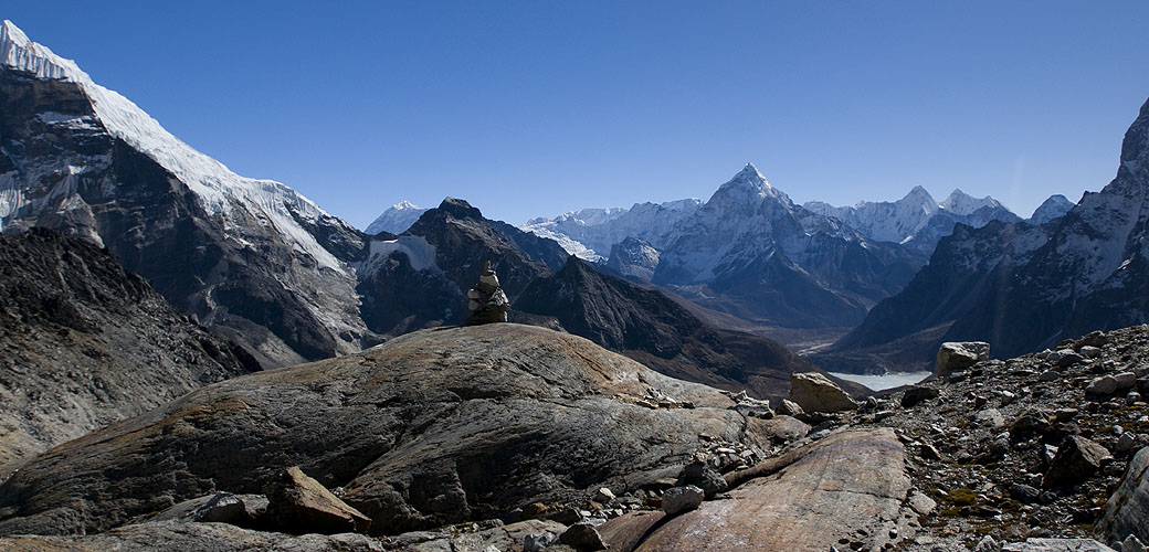 Actually taken from just below the pass on the eastern side. The peak far left is Lobuje Peak (6113m), with Baruntse (7220m), Chamlang (7253m), Ama Dablam (6856m) and Malanphulan (6571m) along the horizon left to rightNikon D300, 17-35mm