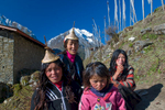 Women at Laya, Bhutan. Wearing the distinctive bamboo hats of the region