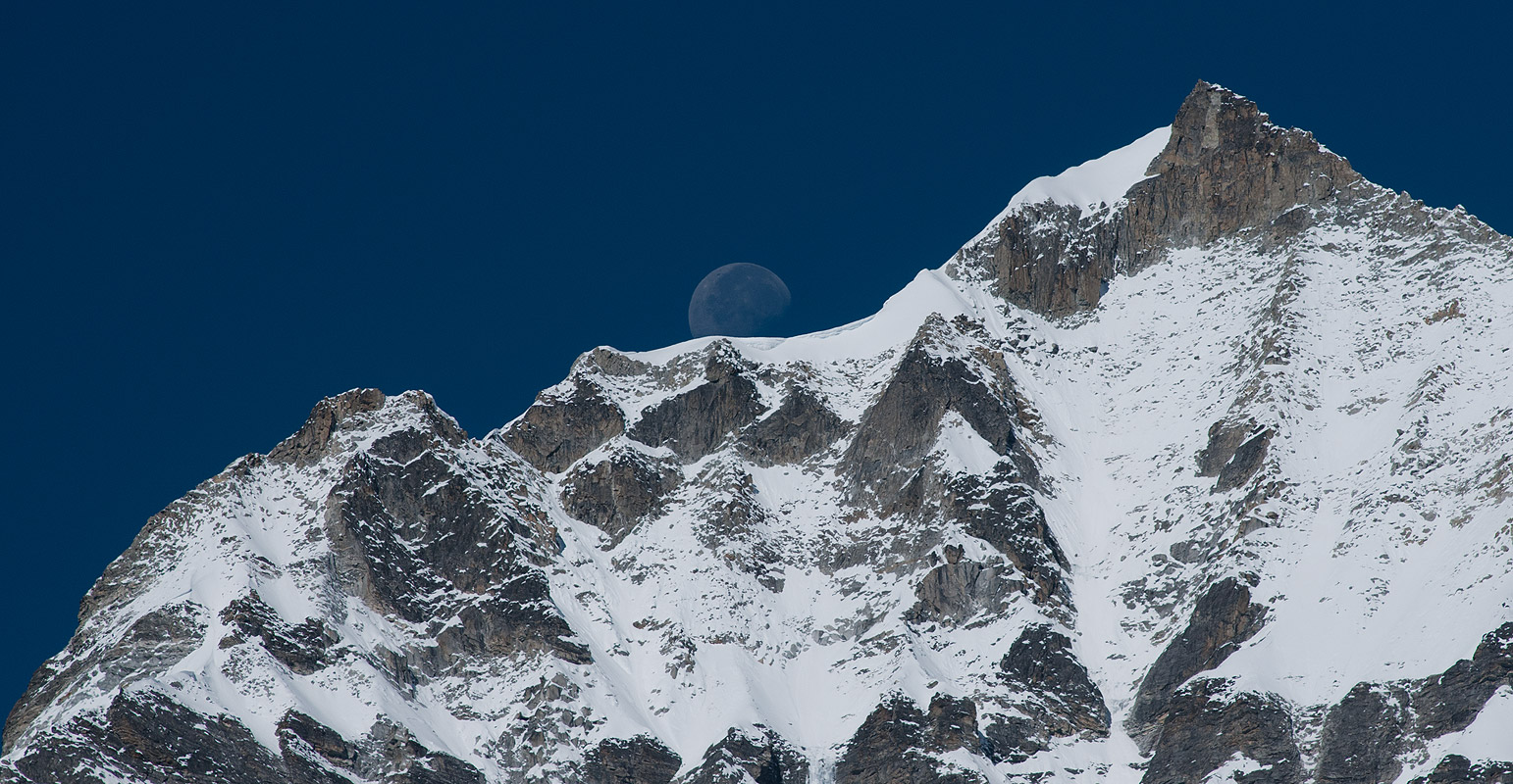 The moon rises over a satellite peak of MasagangNikon D300, 180mm