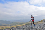 Keswick, Cumbria, September 2009Wilson Chemweno of Kenya rruising to victory and his first gold medal in the men's up-hill race on the summit of Skiddaw