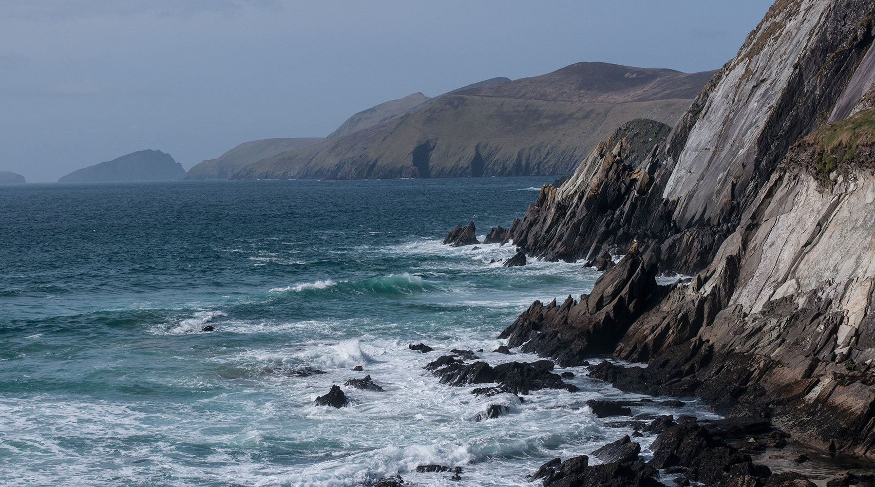 Looking west along the cliffs towards Slead Head & the Blasket IslandsCounty Kerry, Republic of Ireland