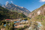 This is the place where the trail from the airstrip at Lukla to Namche Bazaar and Everest crosses the Milke Danda river. These days, during the peak trekking seson, over a hundred flights a day service lukla, and there are thousands of trekkers passing each way every day. Given that most of them will not be carrying their own luggage, but will have either porters or yaks with them, the volume of traffic on the trail can be imagined. It is a circus. Waits of several hours are not uncommon here, as one-way traffic streams across the narrow suspension bridge over the river. Consequently many tea shops and lodges have sprung up...Nikon D300, 17-35mm. November 2008