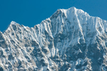 The first close-up view of a Himalayan giant on the walk in to Everest is of Thamserku, through the jungle from the trail near the village of Monjo.Nikon D300, 180mm. November 2008