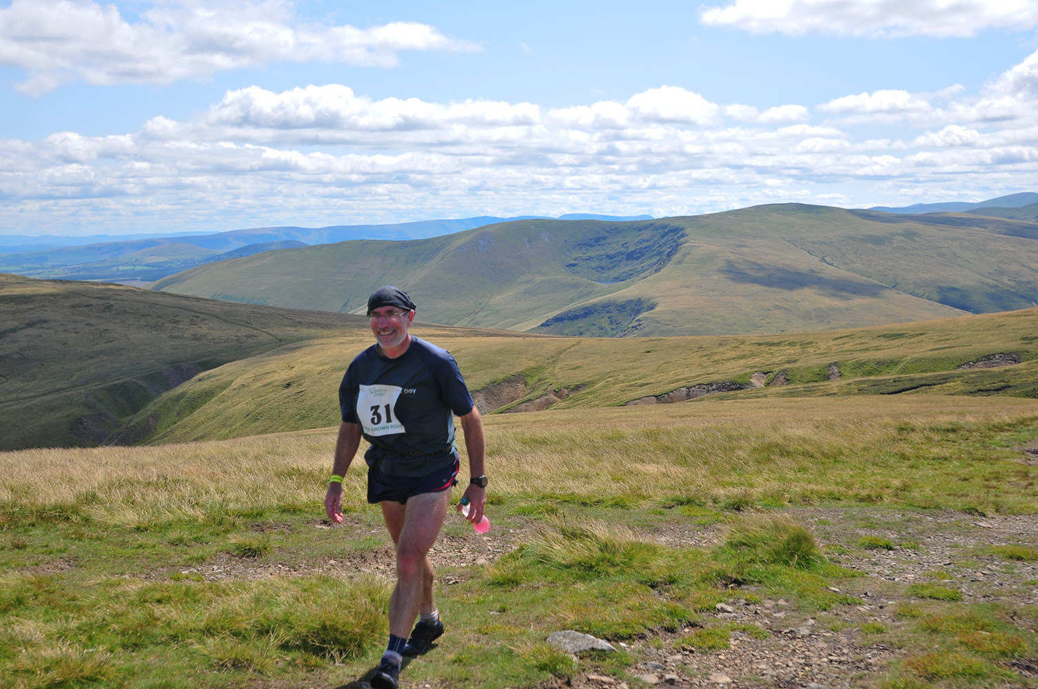 Fell runner from Hesket Newmarket, Cumbria, on the summit of High Pike towards the end of the Old Crown Round in 2009. Pearson won the event, completing the 24 mile round of the Caldbeck Fells in 4hrs 14minutes.
