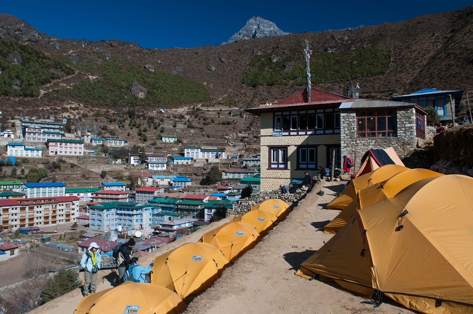 My trekking group camped on a hotel terrace at this gateway village to the Everest region in November 2008. It is at an altitude of 3440m. Namche Bazaar has grown rapidly in recent years as the burgeoning trekking industry bring ever increasing numbers of toursists to the area. Many visitors spend two or tree nights here to acclimatise to the altitude pefore proceeding up valley.Nikon D300, 17-35mm