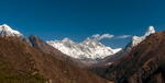 A view up valley from just above Namche Bazaar. Straight ahead, Everest peeps over the towering south wall of Lhotse, on the right is Ama Dablam, and on a low ridge in the middle distance is Tengboche Gompa.Nikon D300, 17-35mm. November 2008