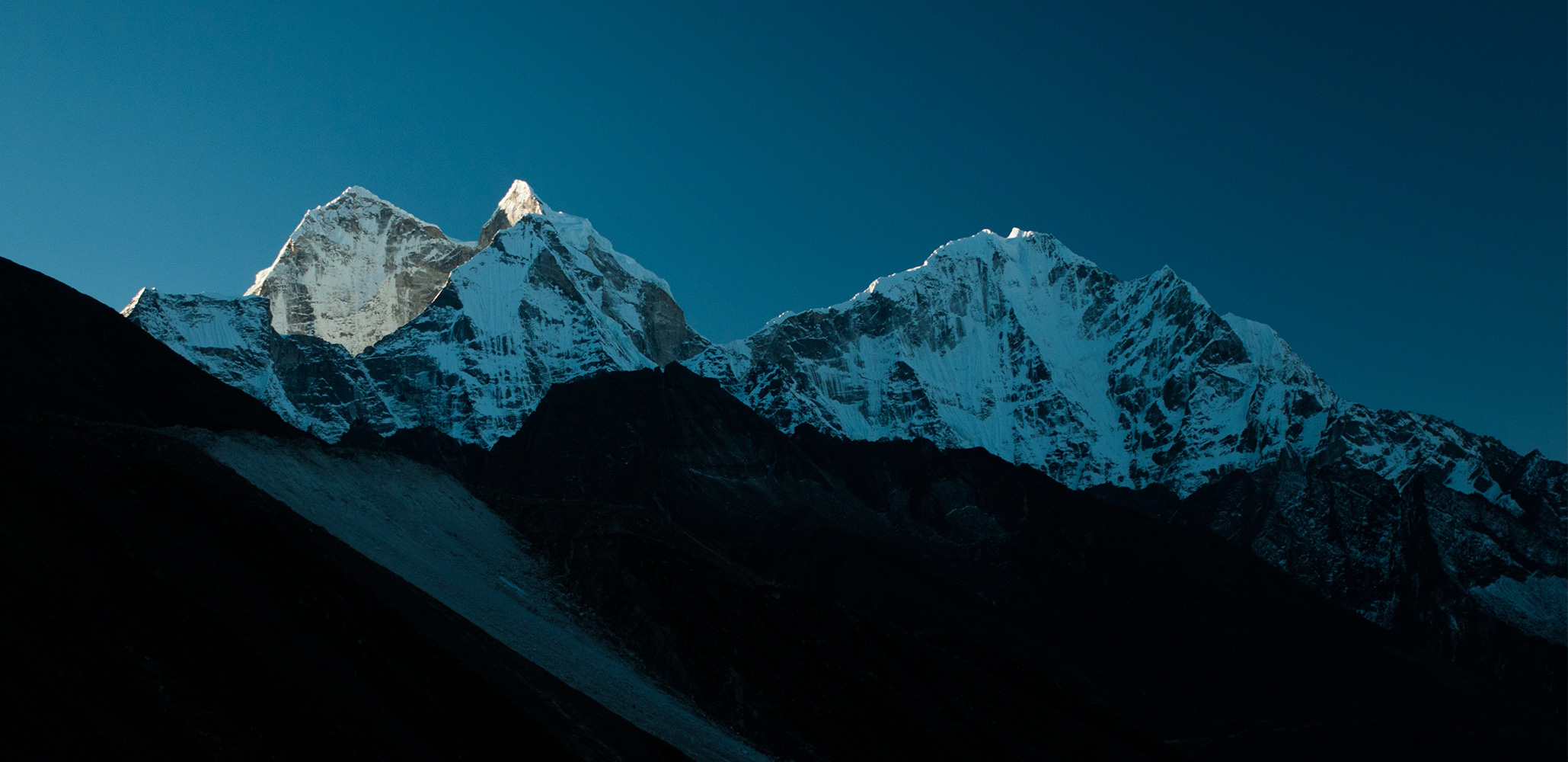 A view back down the Imja Khola valley at sunset to these fabulous peaksNikon D300, 180mm. November 2008