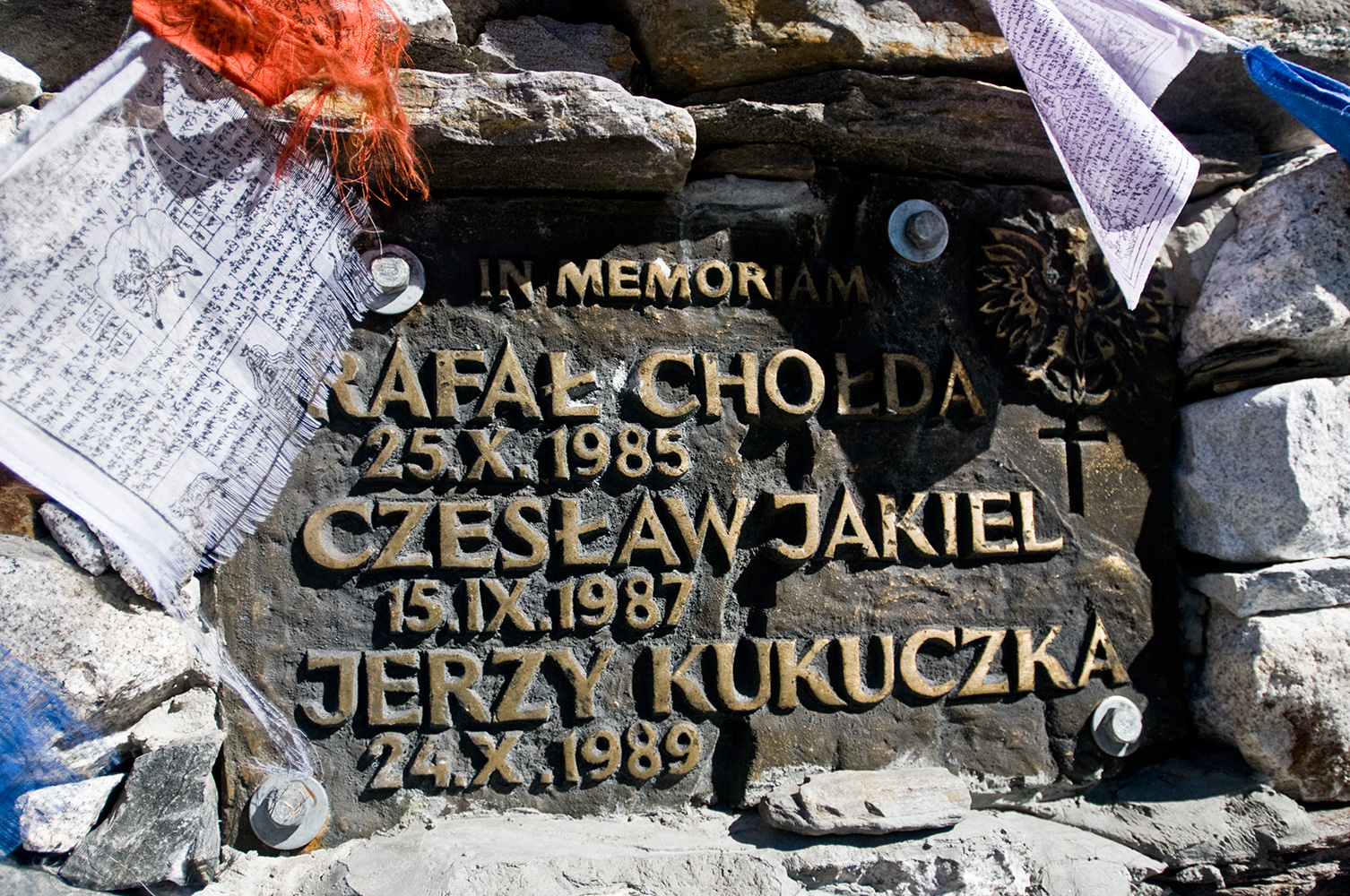 Above Chhukung village, beneath the immense, brooding mass of the south wall of Lhotse, is this memorial to three Polish climbers who perished in separate accidents on the mountain. Rafal Cholda,  Czeslaw Jakiel and Jerzy Kukuczka. Kukuczka was the second person to summit all 14 of the world's 8000m peaks, after Reinhold Messner. He also climber four 8000m peaks in winter and made the first ascent, in Alpine Style, of a new route on K2 (with Tadeusz Piotrowski) which has never been repeated. He was a hard man! Respect. RIP.Nikon D300, 17-35mm. November 2008