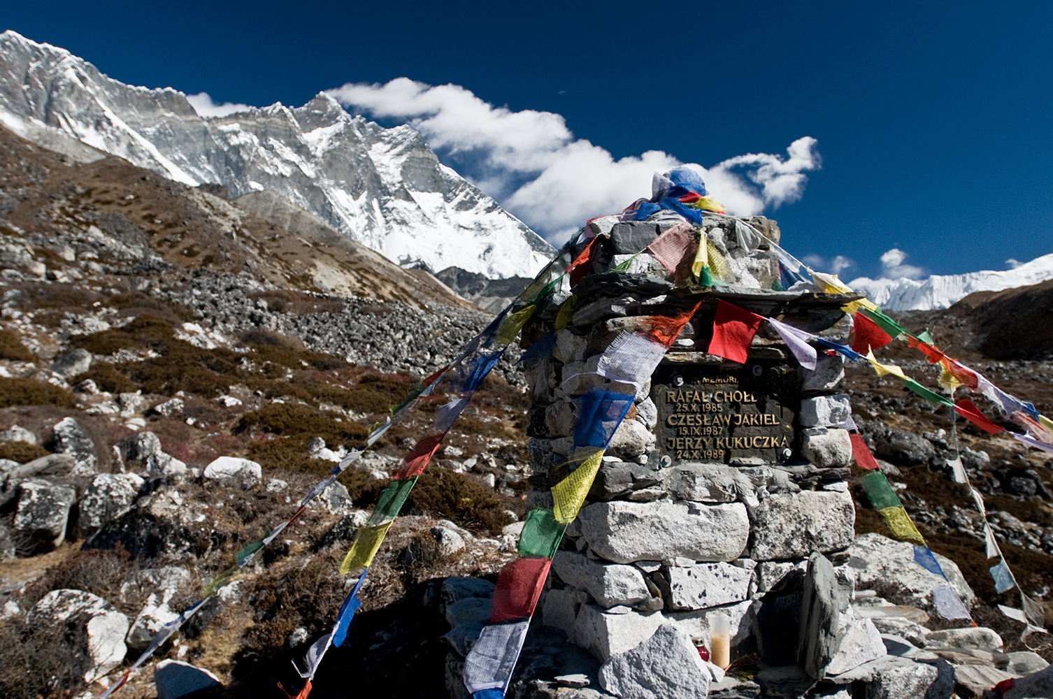 Above Chhukung, beneath the immense, brooding mass of the south wall of Lhotse, is this memorial to three Polish climbers who perished in separate accidents on the mountain. Rafal Cholda,  Czeslaw Jakiel and Jerzy Kukuczka. Kukuczka was the second person to summit all 14 of the world's 8000m peaks, after Reinhold Messner. He also climber four 8000m peaks in winter and made the first ascent, in Alpine Style, of a new route on K2 (with Tadeusz Piotrowski) which has never been repeated. He was a hard man! Respect. RIP.Nikon D300, 17-35mm. November 2008