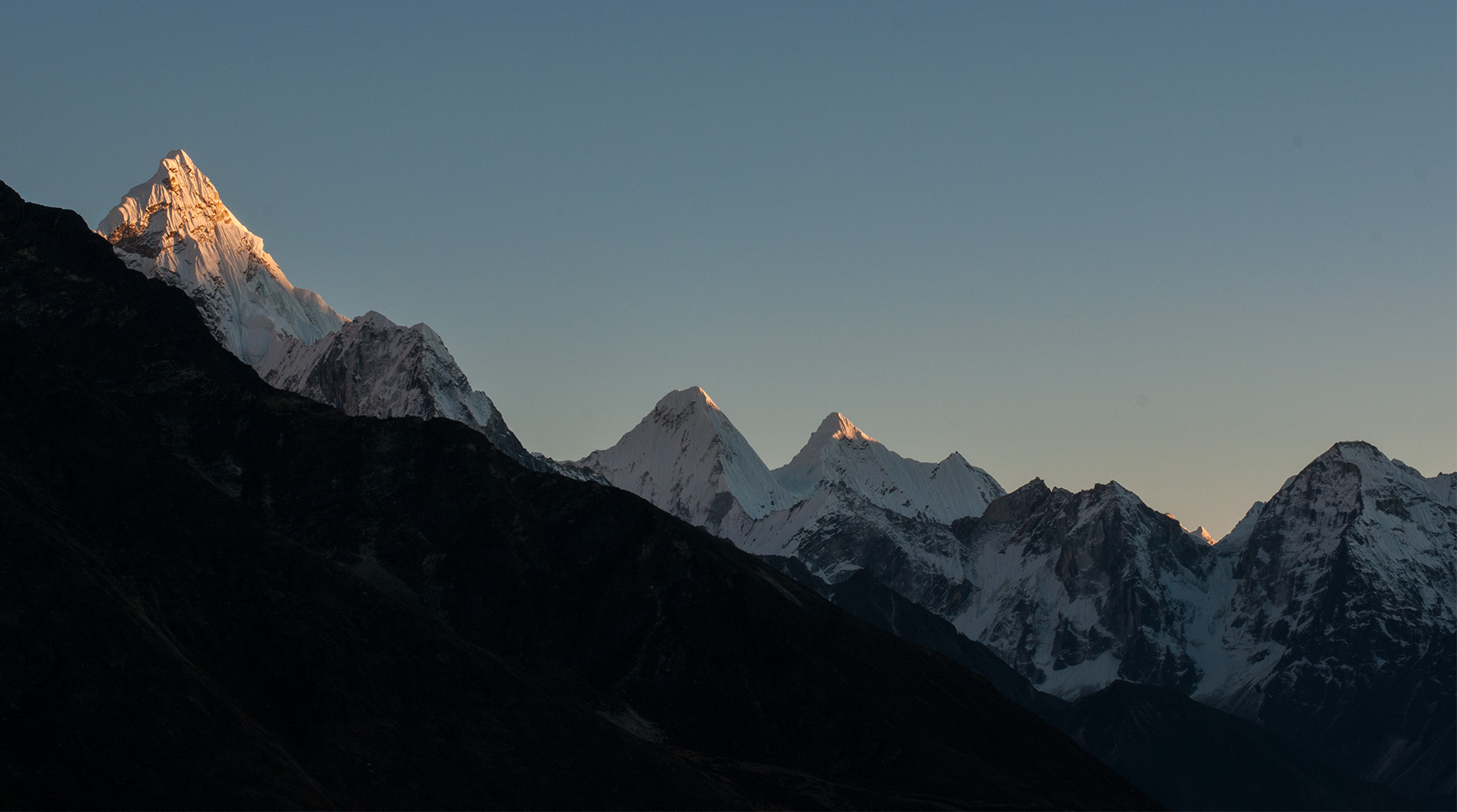 A view south from about halfway up Kala Pattar. On the left is Ama Dablam, with Kantega and Thamserku beyond.Nikon D300, 17-35mm
