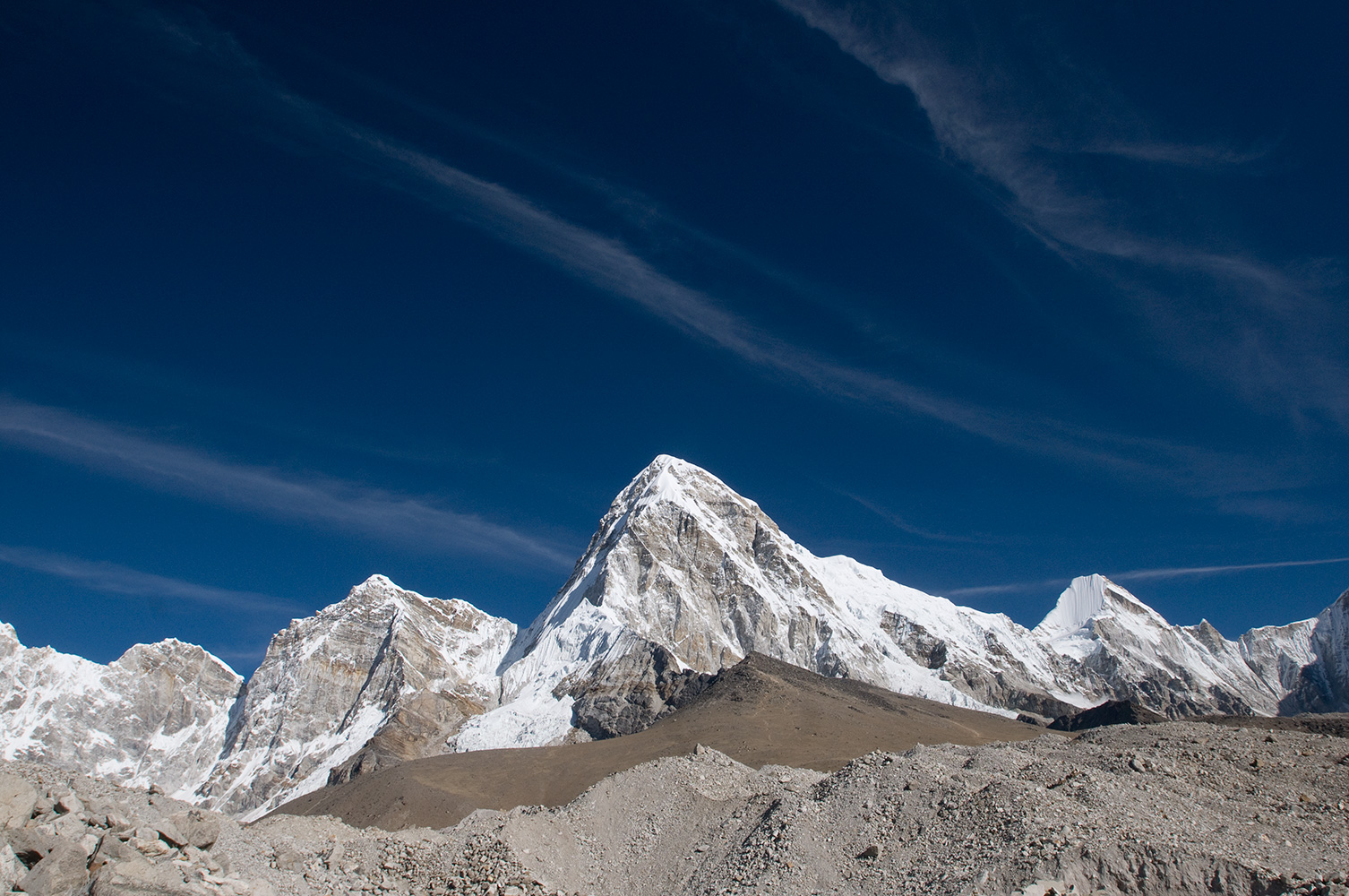 From the Changri Shar glacier below Gorak Shep. Kala Pattar clearly visible immediately below the main peak.Nikon D300, 17-35mm. November 2008