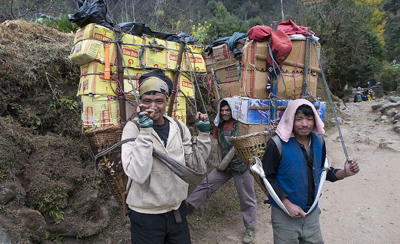 Much is made of the need for trekkers and trekking agencies to look after and equip their porters properly, but few realise the true cost of that cold beer they sip at Gorak Shep. Porters carrying supplies into the Khumbu for lodges, tea houses and shops frequently carry loads in excess of 80kg.Nikon D300, 17-35mm