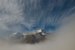 Mountains appearing through the morning mist at Khumjung vilage. December 2008