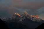 From Thame Village in the Khumbu. On the far left is Melanphulan (6573m) in shadow, with Kantega, Thamserku and Kyashar catching the last rays of the sun.Nikon D300, 50mm. December 2008