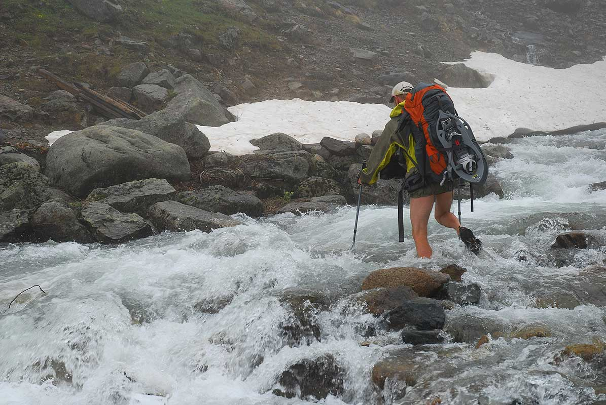Crossing a river below the Neletleme PassThis photograph © Stefano Ardito