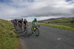 Bardiani GreenTeam leads the peleton over Caldbeck Commons in Cumbria on Stege 2