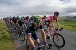 Bradley Wiggins tucked into the peleton on Caldbeck Commons, Cumbria, during Stage 2