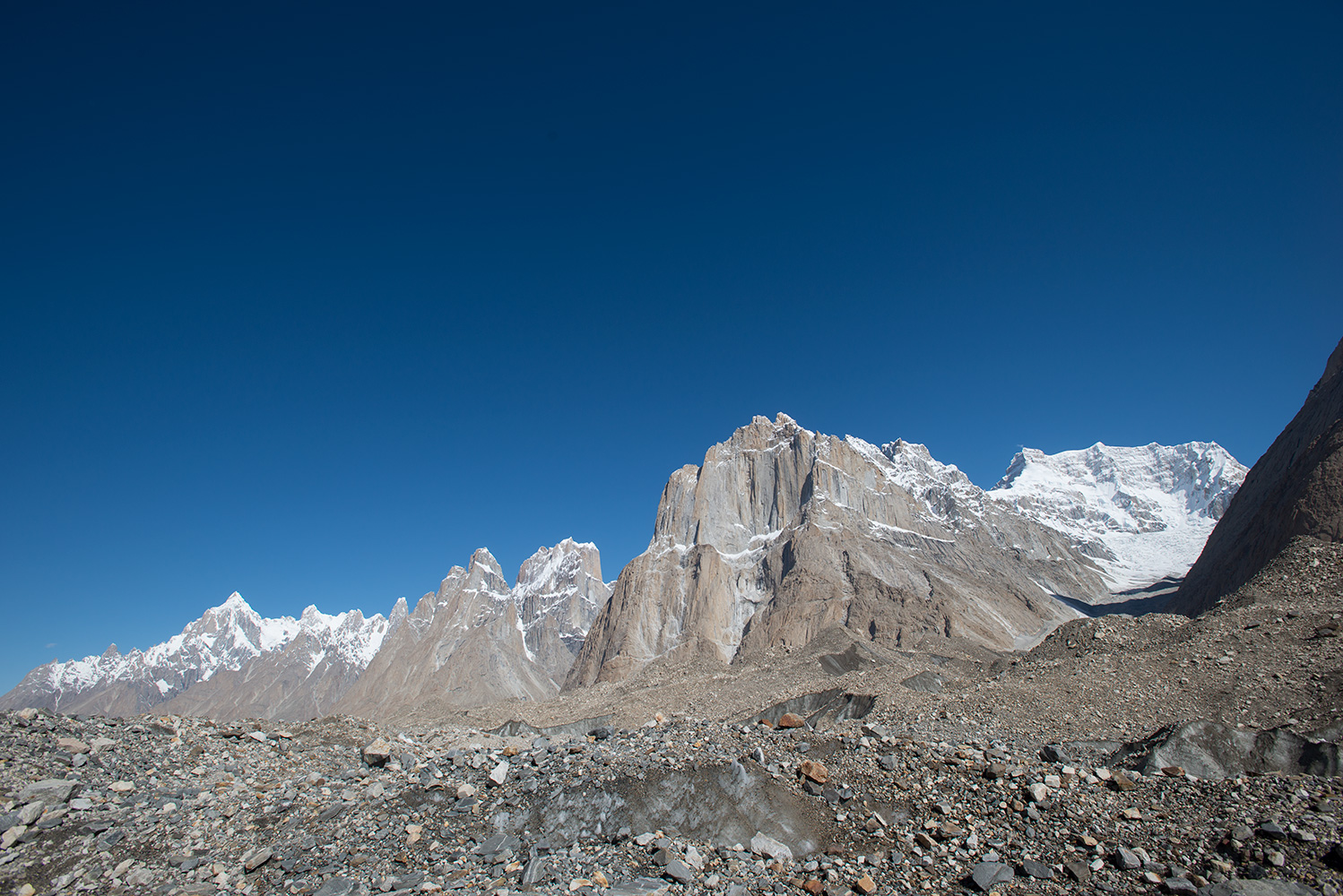 A view of the peaks lining the northern flanks of the glacier from near Urdokas. Paiju Peak, the Trango Towers, Cathedral Spires and Biale