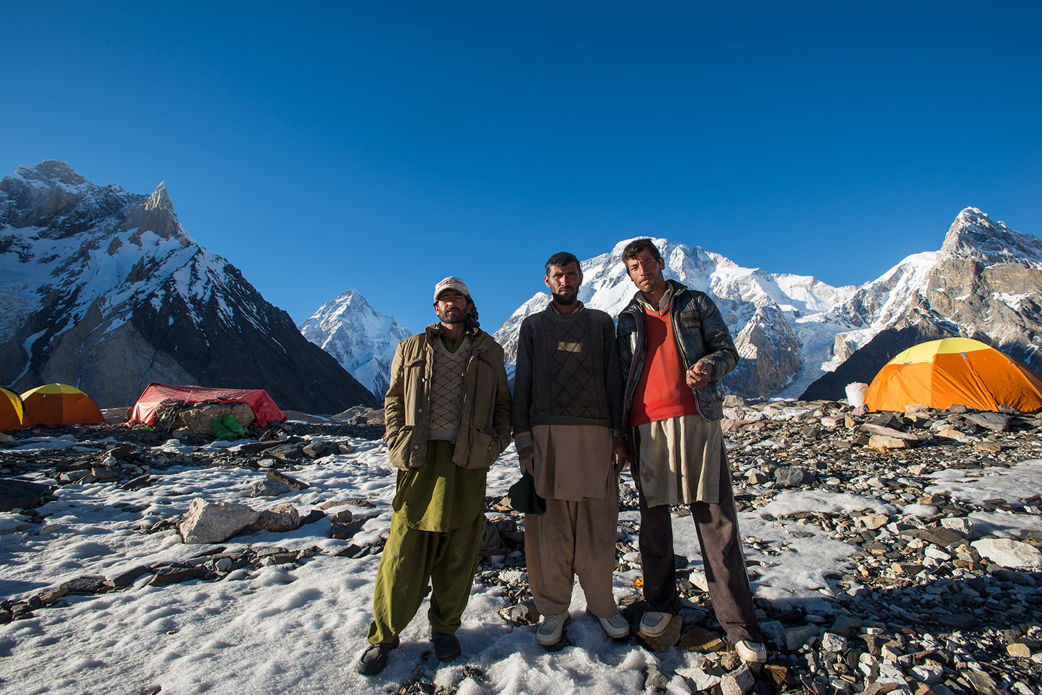 Three of our Balti porters pose for a picture in front of K2
