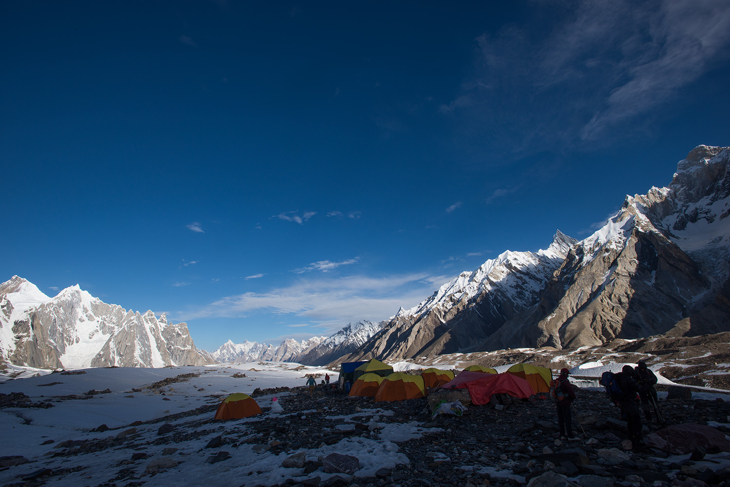 As the afternoon shadows engulf the camp, temperatures plummet. A view down valley to Paiju Peak and the Trangos etc