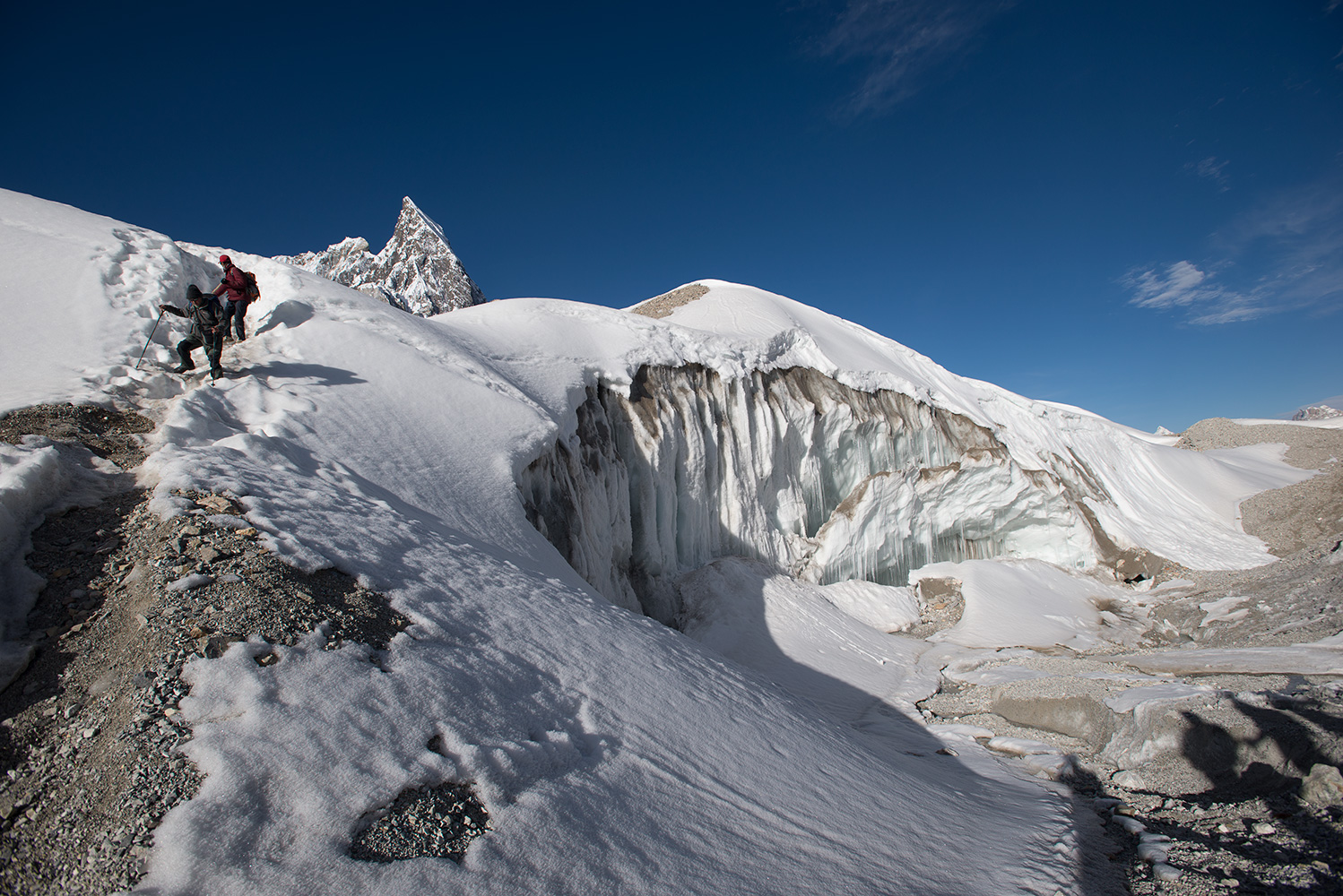 Tricky ground on the way from Concordia to Broad Peak base camp. Mitre Peak overhead.