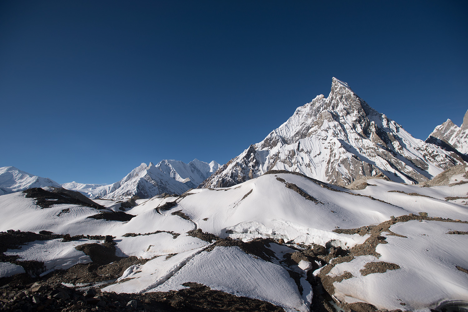 The further you get from Concordia towards Broad Peak base camp, the more the view up the Baltoro opens up. On the left is the Golden Throne aka Baltoro Kangri, and centre is Bride Peak aka Chogolisa. Left of centre, over the visible Kondus Saddle is Kondus (6756M) which is actually in India. At the risk of offending people on both sides, I will say that it is lamentable that this area has so long been the subject of petty squabbles and skirmishes, and that the entire range should be de-militarised and made a zone of peace. Open to everyone!