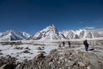 With a view back across Concordia to the Baltoro. In the centre is Mitre Peak, with the Vigne glacier and Chogolisa to the left and the Baltoro and Biarchedi etc to the right. In the picture are Jim Hartill, Sandy Masson and Zulfikar