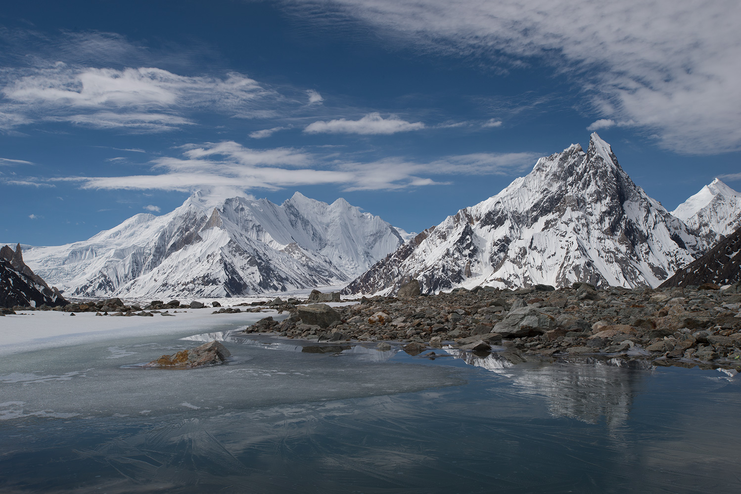 Chogolisa (summit in cloud), the confluence of the Vigne and Baltoro glaciers and Mtre Peak, from the way to Braod Peak base camp