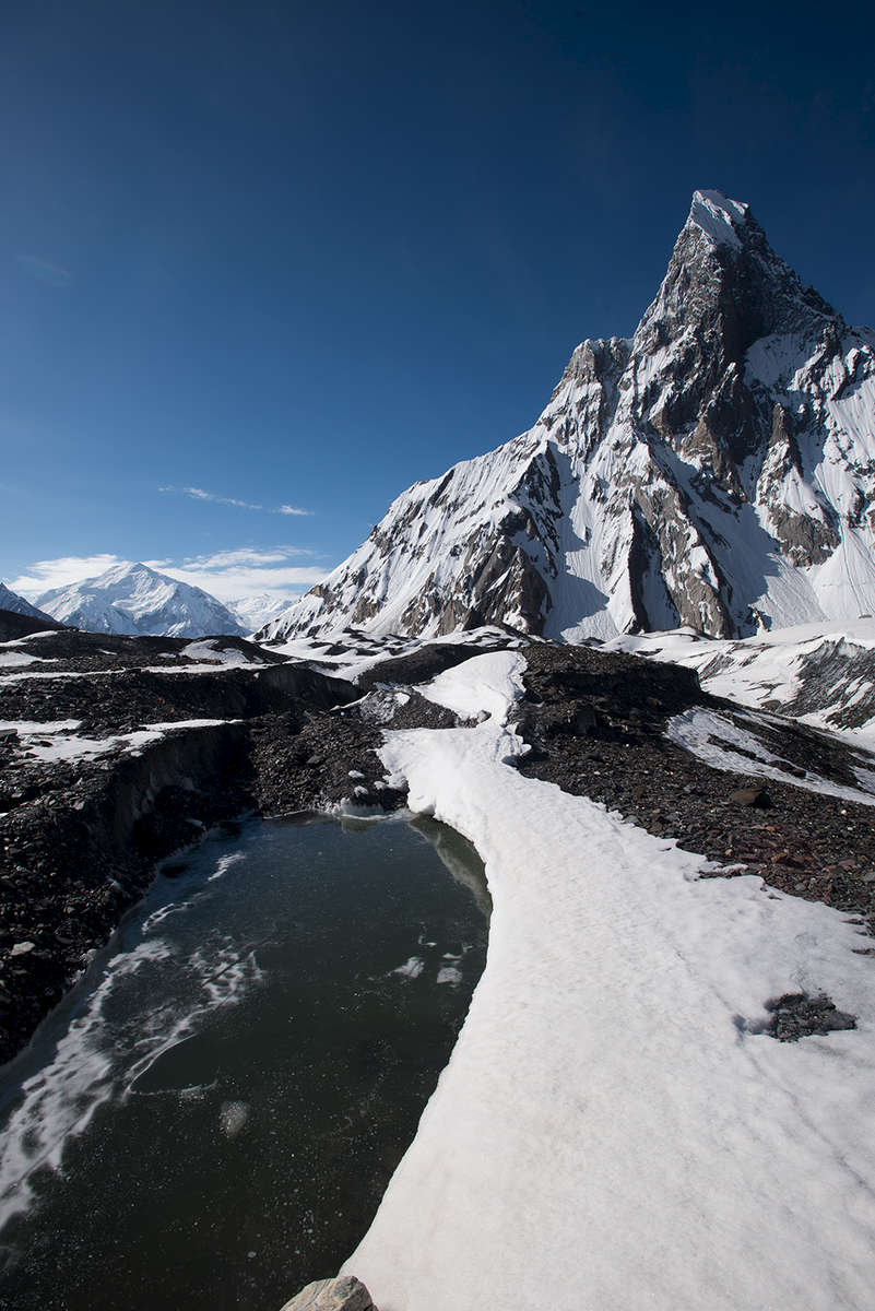 Mitre Peak towering overhead from near Concordia, with Baltoro Kangri beyond