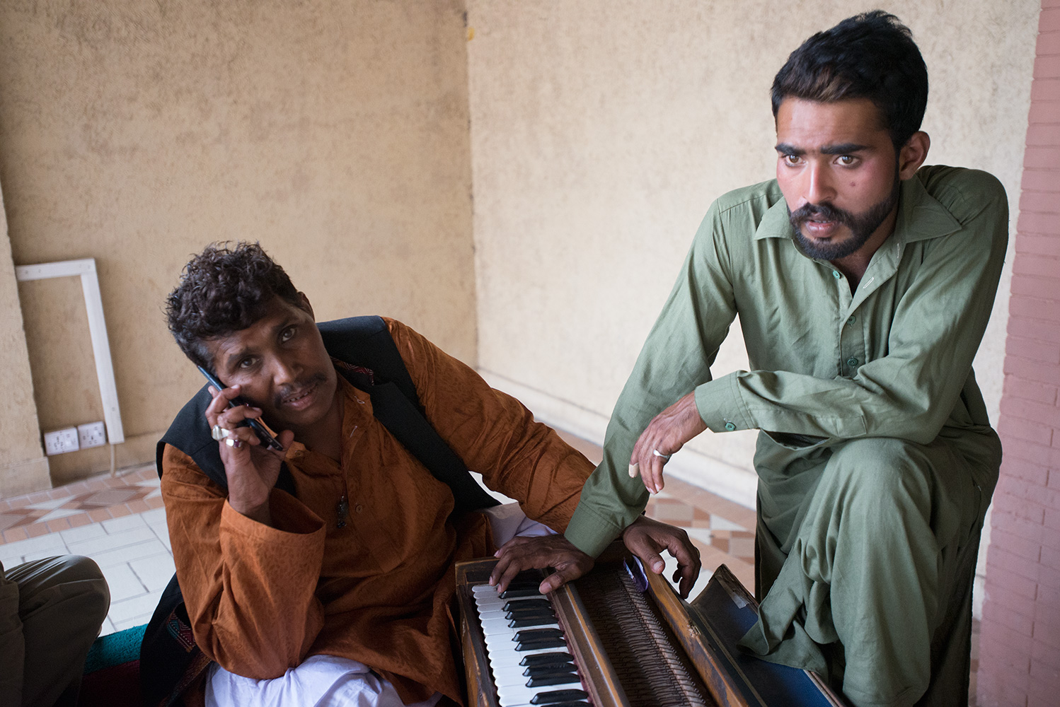 Qawalli musicians busking outside